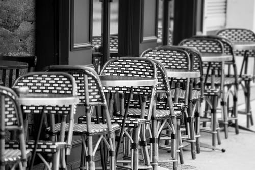 Grayscale Photo of Chairs