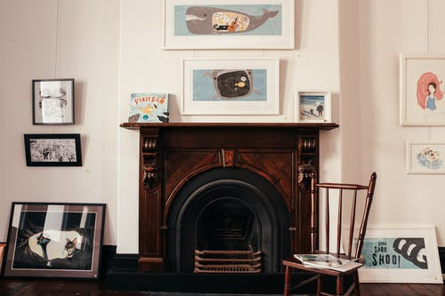 Brown Wooden Fireplace Mantle With Picture Frames