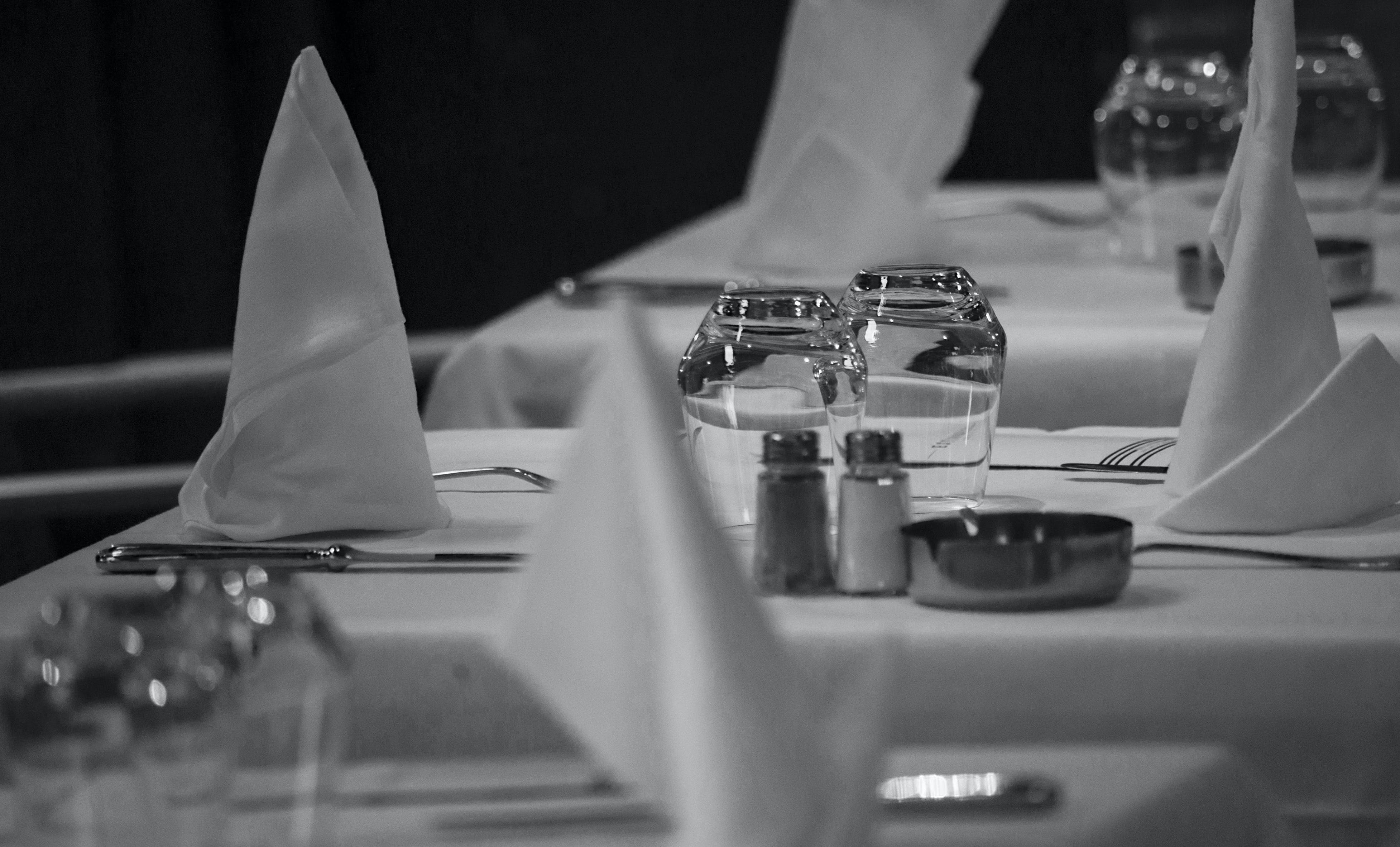 Grayscale Photo of Table Arrangement