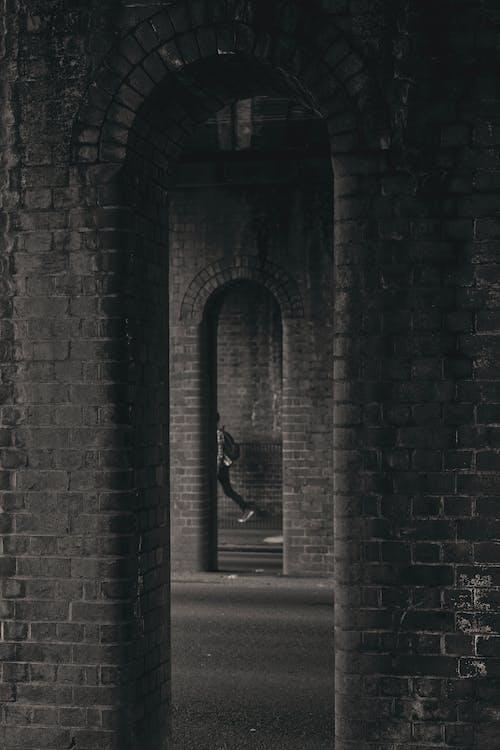 Black Metal Door on Gray Brick Wall