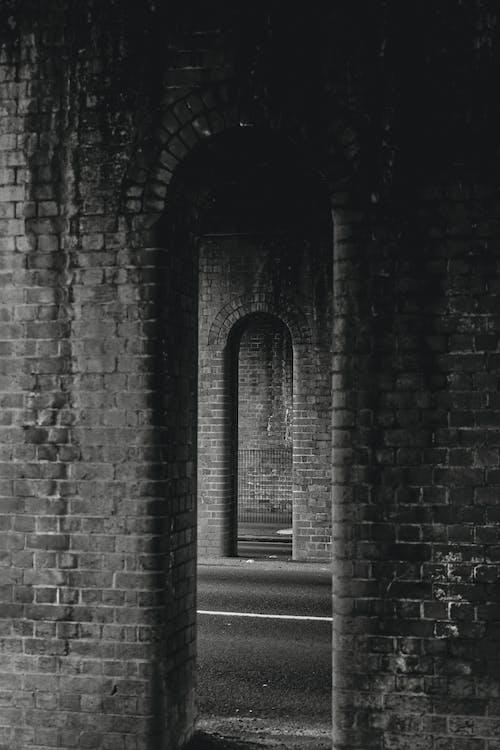 Grayscale Photo of Brick Wall