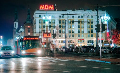 Free stock photo of bus, cars, city lights city street
