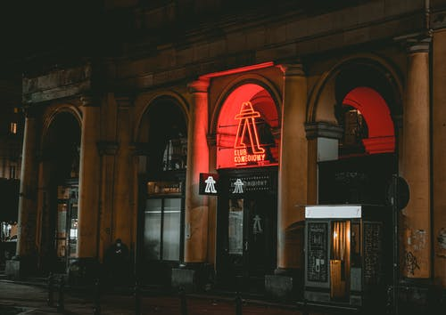 Red and White Building during Nighttime