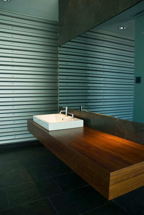 Brown Wooden Table With White Ceramic Sink
