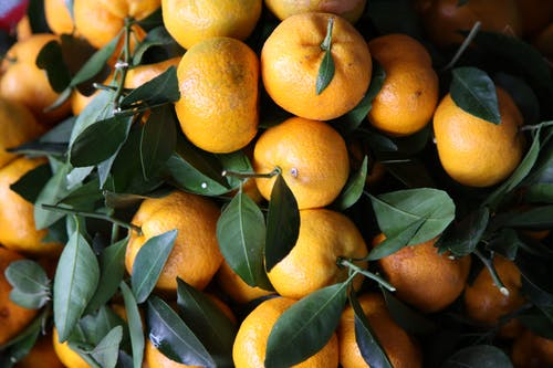 Fresh mandarins with leaves in light place