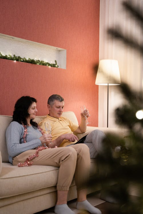 Couple Sitting on Couch Having A Video Chat