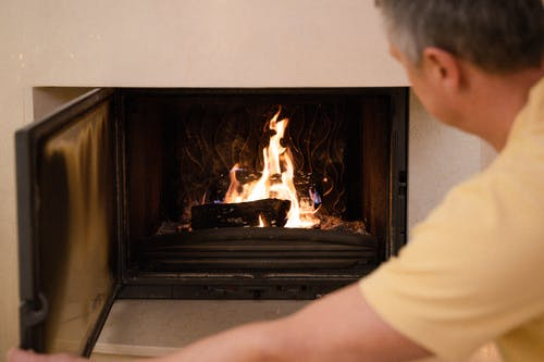 A Man Looking at the Fireplace
