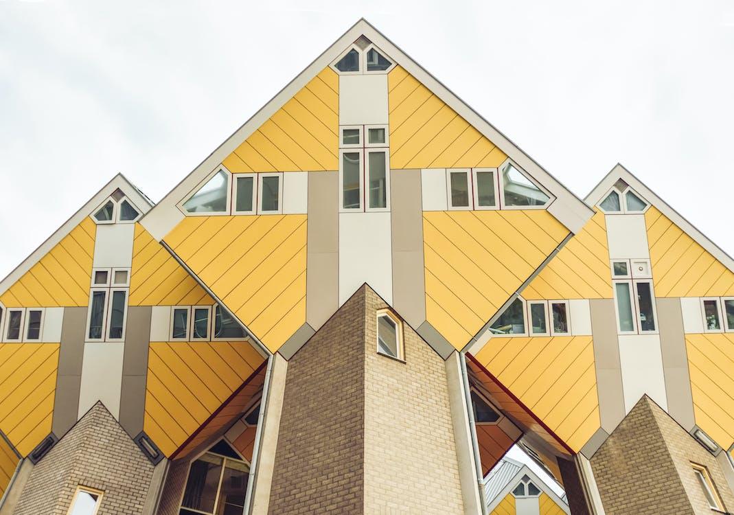Creative hexagon shaped houses against cloudy sky