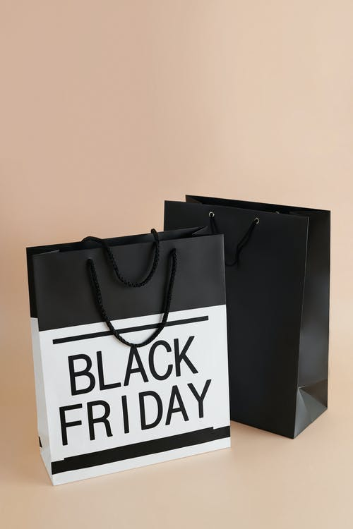 Two Paper Bags with Black Friday Sale Text