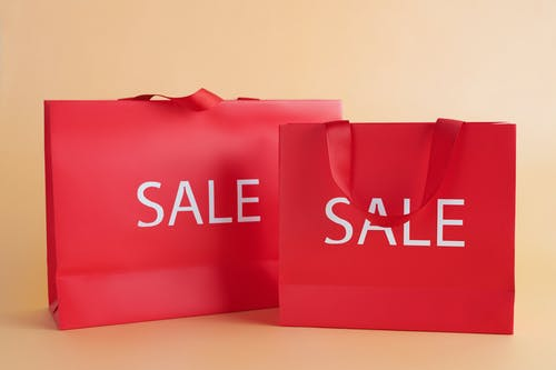 Red Gift Bags With Sale Sign