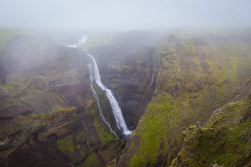 Waterfalls Surrounded by Fogs