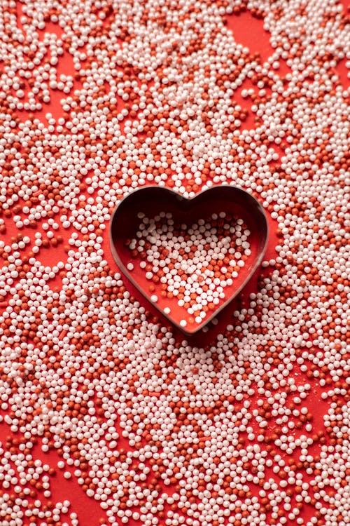 Heart near sprinkling on surface for Valentine day