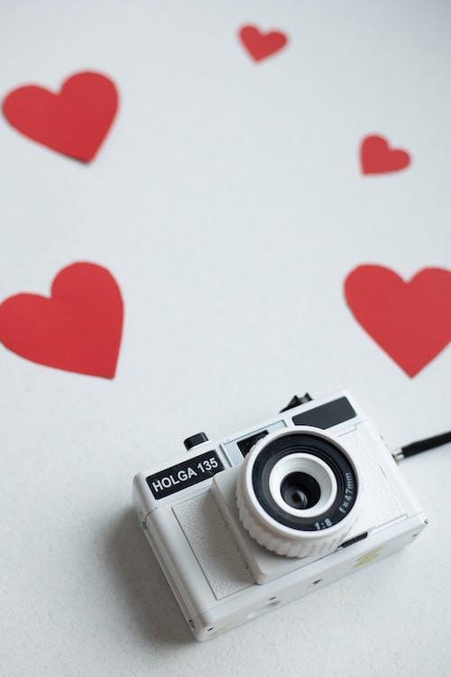 Red hearts and retro photo camera