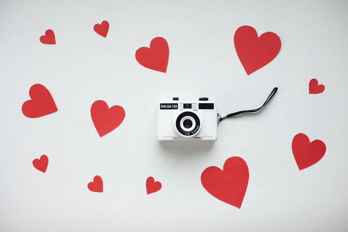 Retro camera with paper hearts