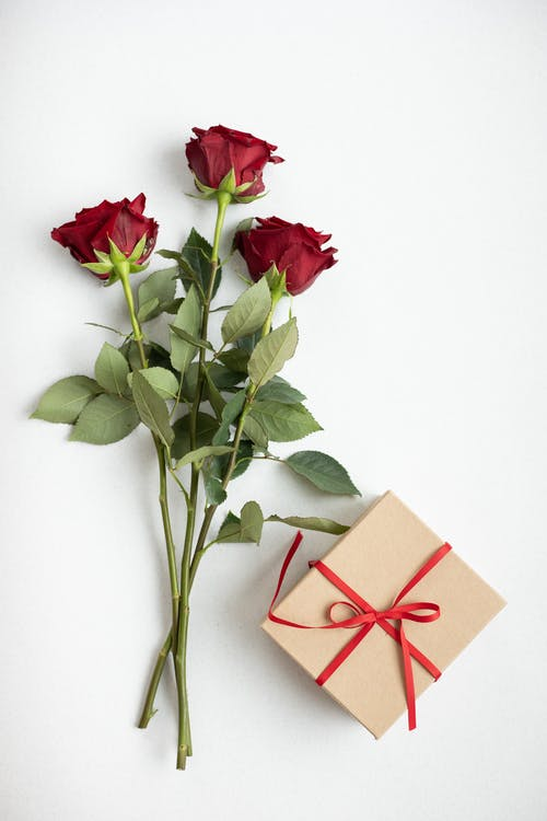 Gift box and fresh flowers