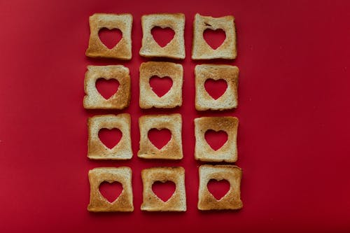 Creative slices of toasted bread placed on red background