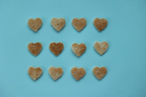 Hearts from bread on blue background