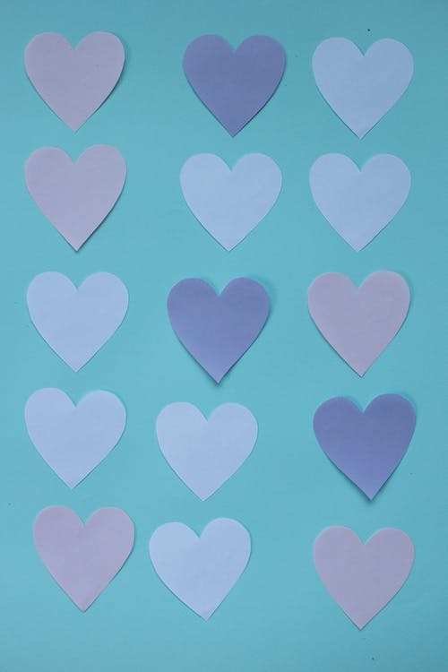 Set of paper hearts on table