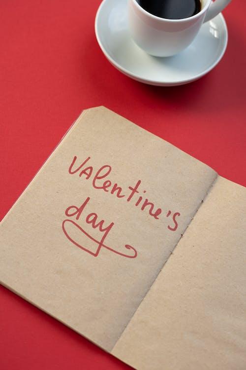 Handwritten phrase on notepad near coffee