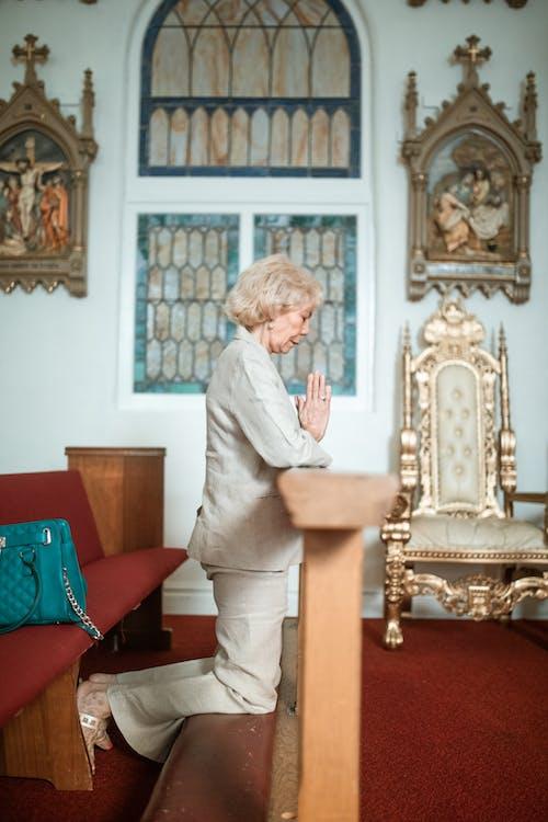 A Woman Praying in the Church