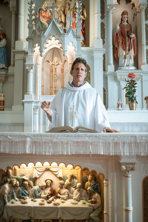 White Ceramic Religious Figurine on White Table