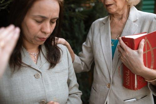 Woman in White Blazer Holding Smartphone