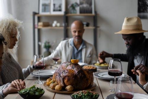 Diverse people praying on Thanksgiving