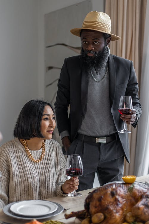 Diverse couple with glasses of wine