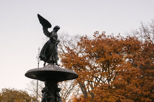 Angel of the Waters statue against autumn trees