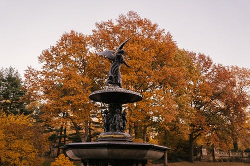 Fragment of Bethesda Fountain with Angel of the Waters statue placed in Central Park in New York City in America in autumn time