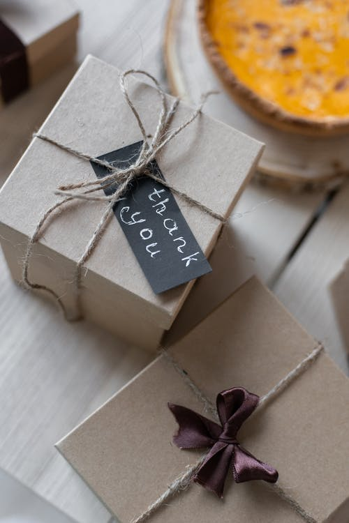 Gift boxes on table tied with ropes