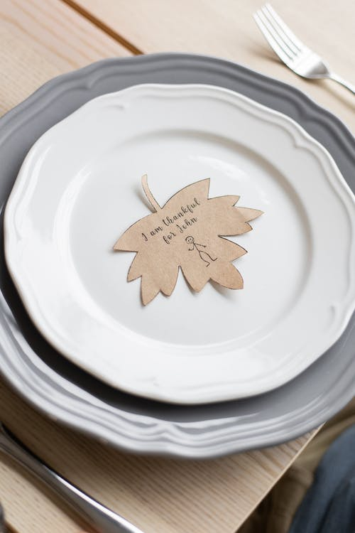Plate with cutout postcard on Thanksgiving