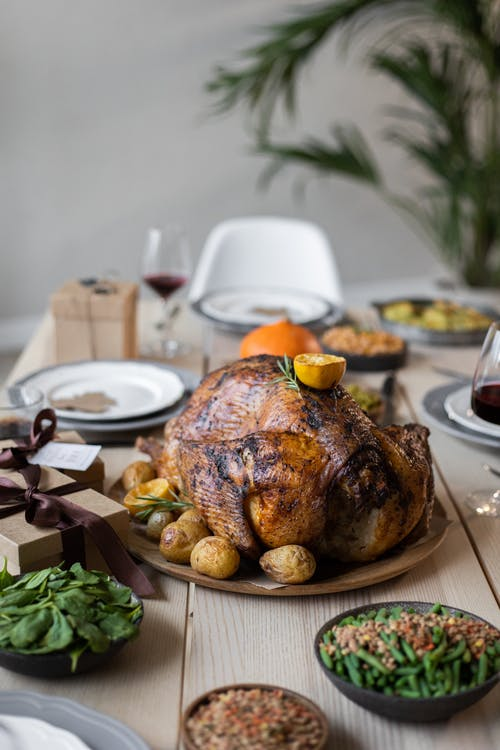 Wooden table served with tasty dishes on Thanksgiving Day