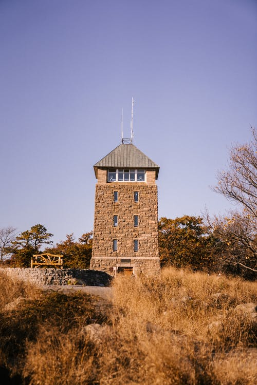 Small tower near autumn forest