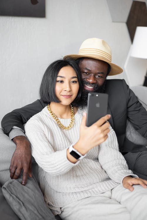 Delighted diverse couple having video call with child