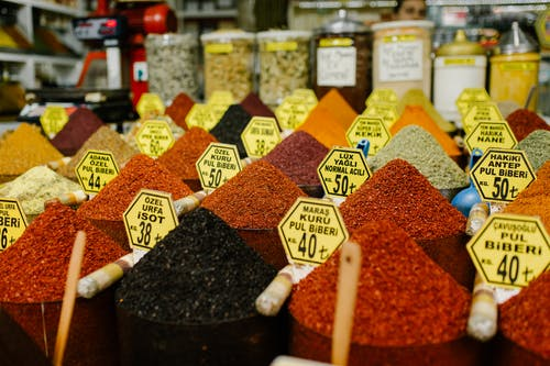 Assorted Spices on Clear Glass Containers