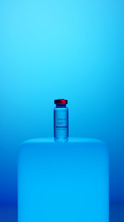 A Vaccine Vial on Blue Background