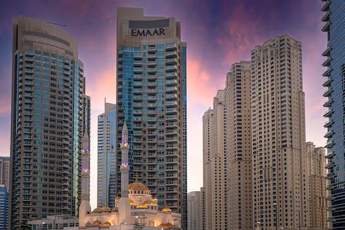 Foto profissional grátis de arranha-céu, céu bonito, cidade