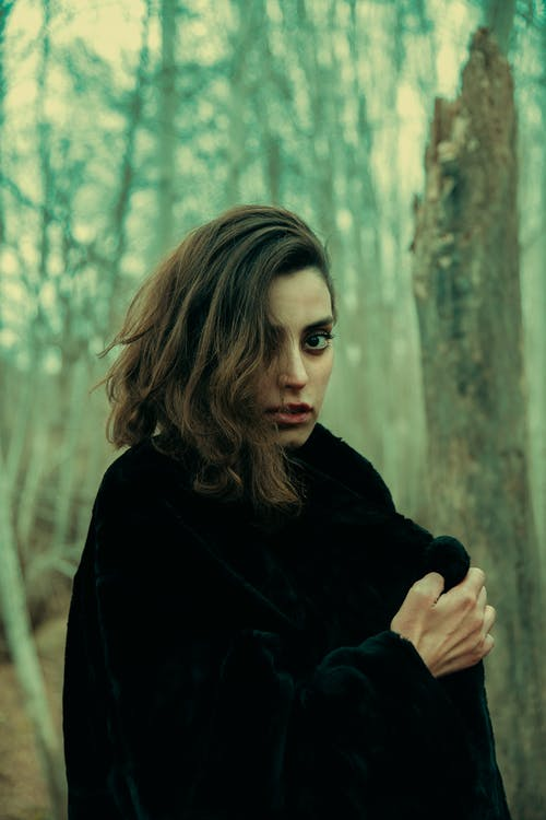 Woman in Black Coat Standing Near Tree