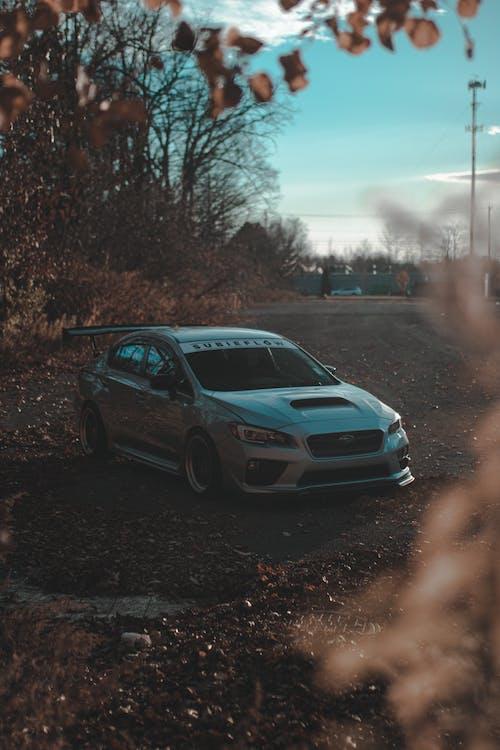 Blue Sedan on Road