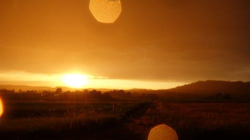 Ilmainen kuvapankkikuva tunnisteilla kentät, märkä linssi, sade