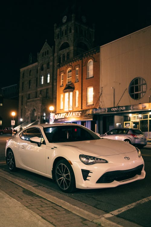 Modern sports car on road in night city