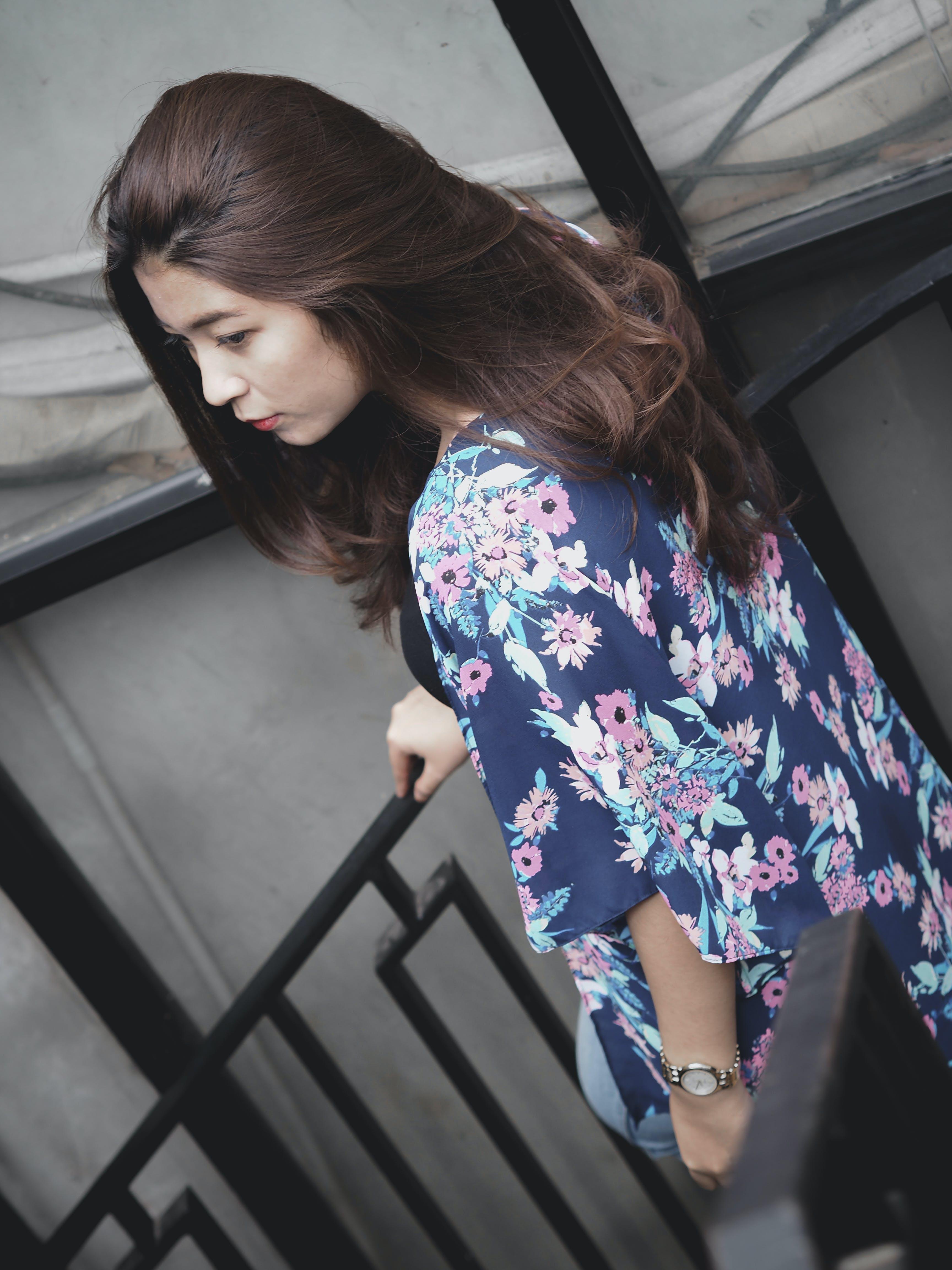 Photo of a Woman Wearing Floral Kimono