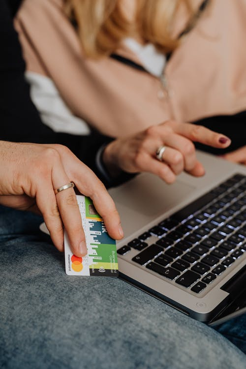 A Person Holding a Bank Card