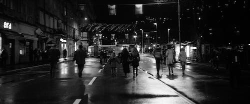 People Walking on Street during Night Time