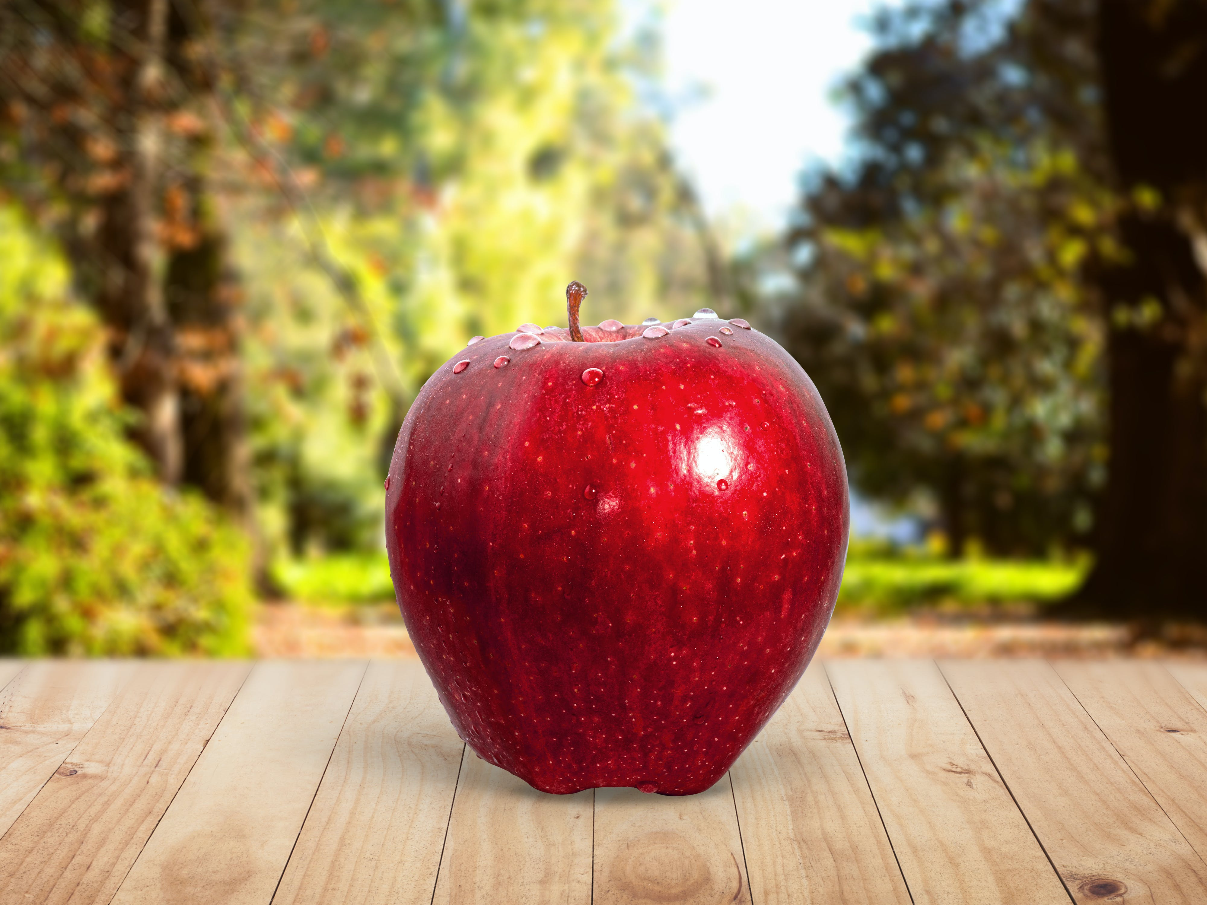 Red Apple Placed on Table