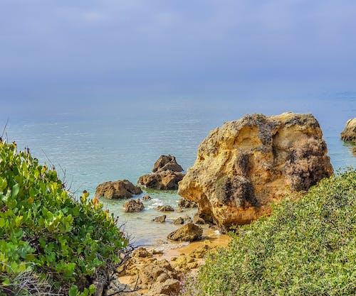 Foto profissional grátis de algarve, faro, linha costeira