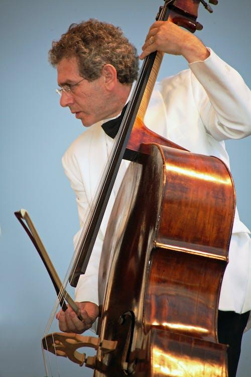Man Playing Brown Cello