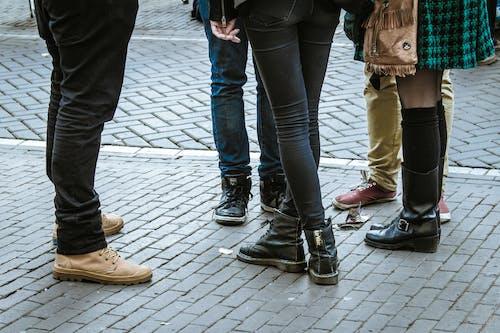 People Standing on Gray Brick Pavement