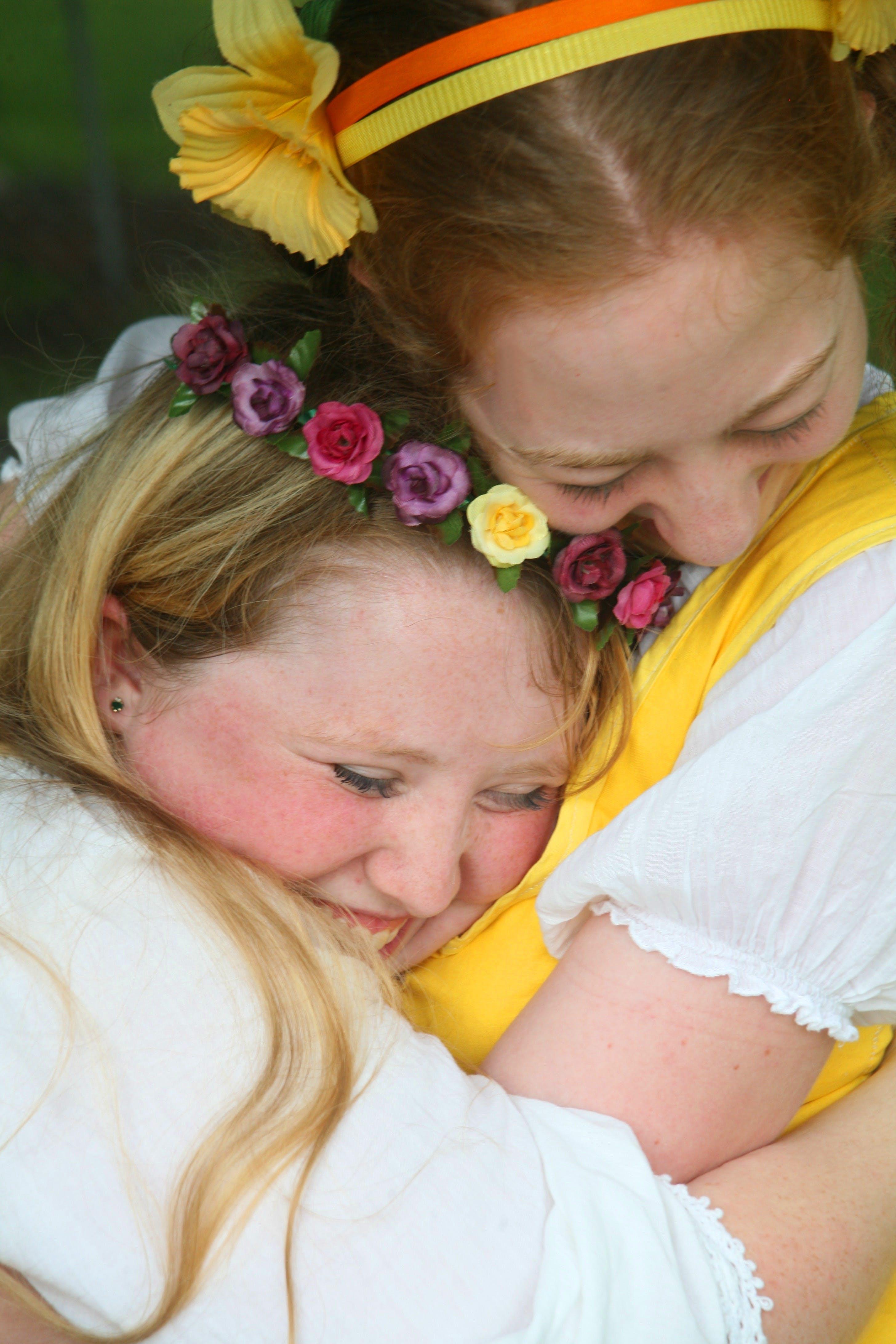 Free stock photo of happy, hug, flower girls